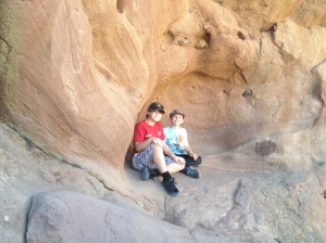 Two boys hiking in a cave, CA