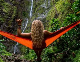 Lady in hammock watching waterfall