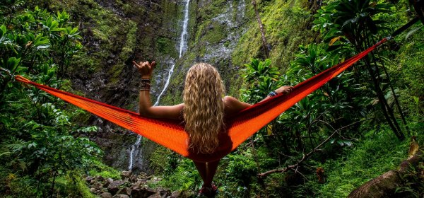 Lady in hammock watching waterfall